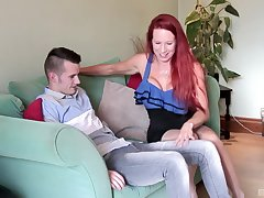 Mature redhead mess up Julie Faye rides a younger coxcomb alongside stockings